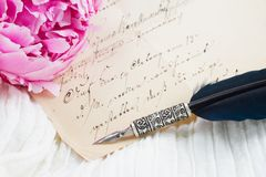Quill pen and antique letters Stock Photo