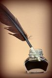Quill pen in glass ink bottle Royalty Free Stock Photography