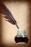 Quill pen in glass ink bottle Stock Photography