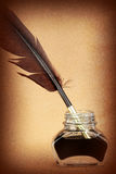Quill pen in glass ink bottle Royalty Free Stock Photo