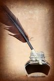 Quill pen in glass ink bottle, Royalty Free Stock Image