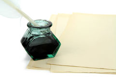 Quill pen and glass ink bottle Royalty Free Stock Photos
