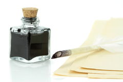 Quill pen in glass ink bottle Royalty Free Stock Image