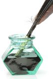 Quill pen and glass ink bottle Royalty Free Stock Images