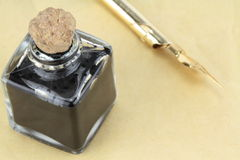Quill pen and ink bottle Stock Photos