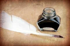 Quill pen and ink bottle stock photography