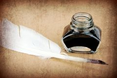 Quill pen and ink bottle Royalty Free Stock Photo