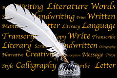 Quill pen and inkwell on black background Royalty Free Stock Image