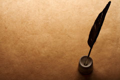Quill pen and inkwell Stock Photography