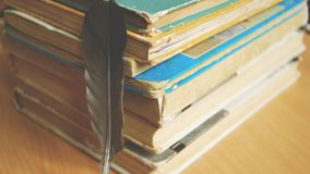 Quill pen and old books stock image
