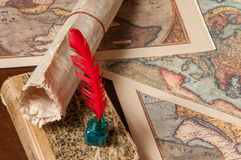 Quill pen and old maps Royalty Free Stock Image