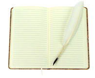 Quill pen on a open notebook. Vintage image. Stock Photos