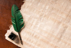 Quill pen and papyrus paper Stock Photos