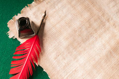 Quill pen and papyrus paper Stock Photography