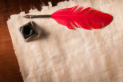 Quill pen and papyrus paper Stock Image