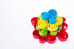 Quilling art. Paper pyramid on the white background Royalty Free Stock Photography