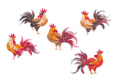 Quilling handmade picture roosters out of colored paper on white Stock Photography