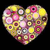 Quilling Heart Mosaic. Heart shape filled with yellow and pink circle quilling mosaic on black background Stock Images