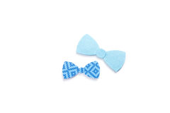 Quilling. Ribbon bow ties on a light background. Family concept. Royalty Free Stock Image