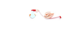 Quilling. Ribbon stork flying with child on a light background Stock Photo