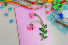 Quilling technique. Making decorations or greeting card. Paper strips, flower, scissors. Handmade crafts on holiday: Birthday, royalty free stock image