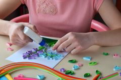 Quilling technique. Paper strips, flower, scissors. Handmade crafts on holiday: Birthday, Mother`s or Father`s Day, March 8, royalty free stock photos