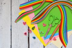 Quilling technique. Paper strips, flowers, scissors, elements. Handmade crafts on holiday theme: Birthday, Mother`s Day, March 8, stock photos