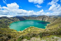 Quilotoa Ecuador lagoon in volcano. With turquoise water. Visit beautiful places in the world and enjoy traveling to unique sights stock image