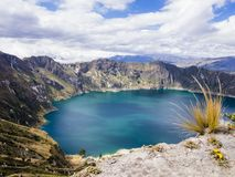 Quilotoa lagoon, volcanic crater lake in Ecuador. Turquoise waters of Quilotoa lagoon, volcanic crater lake in Ecuador Royalty Free Stock Photography