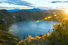 Quilotoa Volcano lagoon. Ecuador. Ilinizas Volcanos under the Quilotoa lagoon at the sunrise, Andes. Ecuador Stock Photo