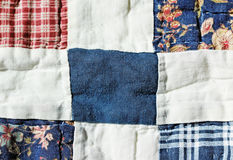 Quilt. Swacthes of square fabrics of different patterns weaved together as quilt Royalty Free Stock Image