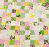 Quilt. Patchwork quilt of yellow, green and pink colors Stock Images