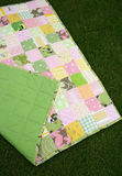 Quilt. Patchwork quilt of yellow, green and pink colors Royalty Free Stock Photo