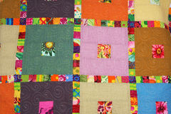 Quilt. Finished hand-made quilt seen from above Royalty Free Stock Photo