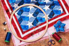 Quilt assembly with stylized elements of the American flag Stock Photos