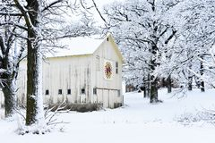 Quilt Barn in a Winter Snowy Wonderland. A beautiful white, rustic barn with a colorful quilt on it in a snowy, winter wonderland in Walworth County, Wisconsin Stock Photo
