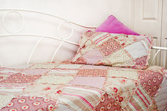 Quilt on bed Stock Photo