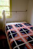 Quilt on Bed in Traditional Historic American Homestead royalty free stock photo
