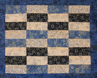 Quilt block. Blue and beige cotton material quilt block Royalty Free Stock Photos