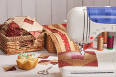 Quilt blocks sewing with an electric sewing machine Royalty Free Stock Photos