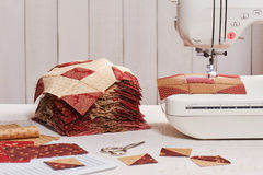 Quilt blocks sewing with an electric sewing machine Royalty Free Stock Photo