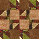Quilt design on a batting cloth. Arranging quilt squares on batting material Royalty Free Stock Photography