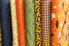 Quilt Fabric. Bolts of Halloween quilt fabric for sale with bats ghosts stars and candycorn stock photo