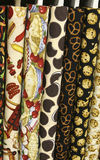 Quilt Fabric. On bolts with food designs including hot dogs, ketchup, mustard, hamburgers, apples and apple pie, cookies, pretzels and chocolate chip cookies royalty free stock photo