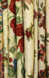 Quilt Fabric. Floral quilt fabric with rosebud, acorn, cherry and blueberry designs in red, green, and yellows stock images