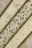 Quilt Fabric. Fabric bolts of quilt fabric in spring and neutral colors with flowers and floral designs royalty free stock photography