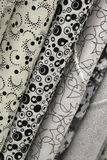 Quilt Fabric. Fabric Bolts of quilt fabric in black and white abstract designs royalty free stock image