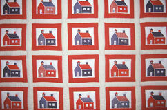Quilt with farmhouse pattern Stock Photo