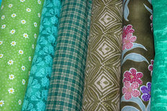 Quilt Greens. Bolts of quilting fabric in the green range Stock Photos