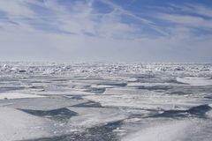 A quilt of ice. Winter on Lake Erie, Ontario Blue sky, square patches of ice stock photos